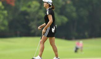 Hinako Shibuno of Japan reacts after putting on the 18th green during the final round of the LPGA Honda Thailand golf tournament in Pattaya, southern Thailand, Sunday, May 9, 2021. (AP Photo/Kittinun Rodsupan)