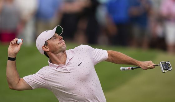 Rory McIlroy throws his ball to the crowd after winning on the 18th hole during the fourth round of the Wells Fargo Championship golf tournament at Quail Hollow on Sunday, May 9, 2021, in Charlotte, N.C. (AP Photo/Jacob Kupferman) **FILE**