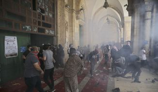 Palestinians clash with Israeli security forces at the Al Aqsa Mosque compound in Jerusalem's Old City Monday, May 10, 2021. Israeli police clashed with Palestinian protesters at a flashpoint Jerusalem holy site on Monday, the latest in a series of confrontations that is pushing the contested city to the brink of eruption. (AP Photo/Mahmoud Illean)