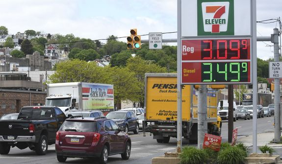 In this file photo, traffic moves along Pennsylvania Route 61 as gas prices are seen on the sign at a Sunoco gas station at East Norwegian Street in Pottsville, Pa., on Monday, May 10, 2021. (Jacqueline Dormer/Republican-Herald via AP)