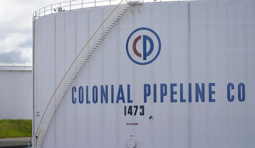 Colonial Pipeline storage tanks are seen in Woodbridge, N.J., Monday, May 10, 2021. Gasoline futures are ticking higher following a cyberextortion attempt on the Colonial Pipeline, a vital U.S. pipeline that carries fuel from the Gulf Coast to the Northeast. (AP Photo/Seth Wenig)