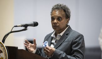 Mayor Lori Lightfoot discusses Chicago's vaccination efforts during a news conference at the Harris Bank Building in the Loop, Monday, May 10, 2021, in Chicago. (Ashlee Rezin Garcia/Chicago Sun-Times via AP)