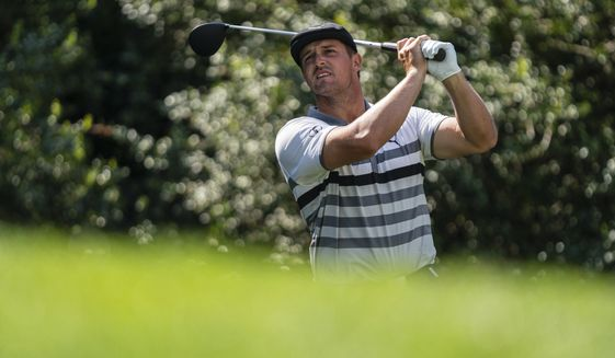 Bryson DeChambeau watches his tee shot on the 14th hole during the third round of the Wells Fargo Championship golf tournament at Quail Hollow on Saturday, May 8, 2021, in Charlotte, N.C. (AP Photo/Jacob Kupferman)