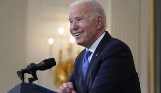 FILE - In this May 5, 2021, file photo President Joe Biden takes questions from reporters as he speaks about the American Rescue Plan, in the State Dining Room of the White House in Washington. Biden is plunging into the next phase of his administration with the steady approval of a majority of Americans, buoyed in particular by the public's broad backing for his handling of the coronavirus pandemic.  A new poll from The Associated Press-NORC Center for Public Affairs Research also shows an uptick in Americans' overall optimism about the state of the country. (AP Photo/Evan Vucci, File)