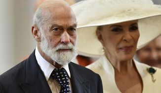 FILE - In this Friday, June 10, 2016 file photo, Britain's Prince Michael of Kent and Princess Michael of Kent arrive at St Paul's Cathedral in London. An investigative report by British media published Sunday,May 9, 2021 says that Queen Elizabeth II's cousin, Prince Michael of Kent, was willing to use his royal status for personal profit and to seek favors from Russia's President Vladimir Putin. The undercover investigation by the Sunday Times and Channel 4 saw reporters posing as investors of a fake South Korean gold company. (Ben Stansall/Pool Photo via AP, file)
