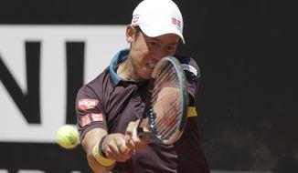 Japan's Kei Nishikori returns the ball to Italy's Fabio Fognini during their match at the Italian Open tennis tournament, in Rome, Monday, May 10, 2021. (AP Photo/Gregorio Borgia)