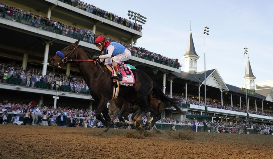 John Velazquez rides Medina Spirit across the finish line to win the 147th running of the Kentucky Derby at Churchill Downs, Saturday, May 1, 2021, in Louisville, Ky. (AP Photo/Jeff Roberson)