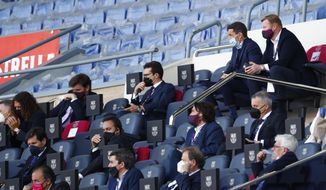 Barcelona's head coach Ronald Koeman, top right, watches from stands during the Spanish La Liga soccer match between FC Barcelona and Atletico Madrid at the Camp Nou stadium in Barcelona, Spain, Saturday, May 8, 2021. (AP Photo/Joan Monfort)