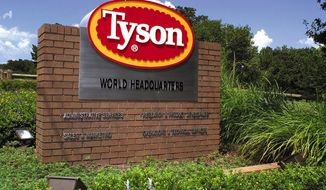 In this July 30, 2001, file photo, a sign marks the entrance to Tyson Foods headquarters in Springdale, Ark. (AP Photo/April L. Brown, File)