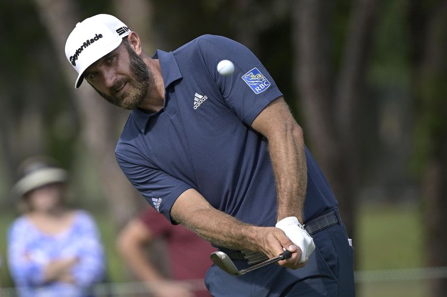 Dustin Johnson chips onto the sixth green during the final round of the Valspar Championship golf tournament, Sunday, May 2, 2021, in Palm Harbor, Fla. (AP Photo/Phelan M. Ebenhack)