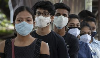 Indian youth above eighteen years age queue up to get vaccinated against the coronavirus in Gauhati, Assam, India, Monday, May 10, 2021. (AP Photo/Anupam Nath)