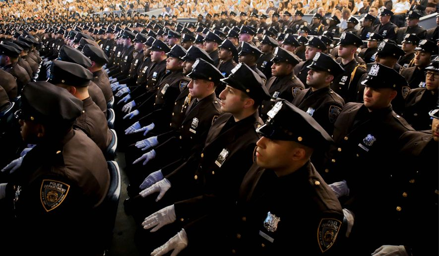National Police Week is this week and it includes a virtual candlelight vigil at the National Law Enforcement Officers Memorial on Thursday. (Associated Press)