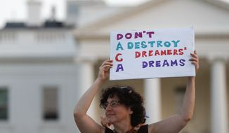 """Julia Paley, of Arlington, Va., with the DMV Sanctuary Congregation Network, holds up a sign that reads """"DACA Don't Destroy Dreamers Dreams"""" during a rally supporting Deferred Action for Childhood Arrivals, or DACA, outside the White House, in Washington, Monday, Sept. 4, 2017. (AP Photo/Carolyn Kaster) ** FILE **"""