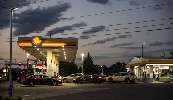Drivers line up for fuel at a Shell Gas Station on Old Forest Road in Lynchburg, Va., Tuesday, May 11, 2021. More than 1,000 gas stations in the Southeast reported running out of fuel, primarily because of what analysts say is unwarranted panic-buying among drivers, as the shutdown of a major pipeline by hackers entered its fifth day. In response, Virginia Gov. Ralph Northam declared a state of emergency. (Kendall Warner/The News & Advance via AP)