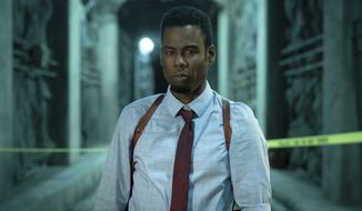 """This image released by Lionsgate shows Chris Rock in a scene from """"Spiral: From the Book of Saw."""" (Lionsgate via AP)"""