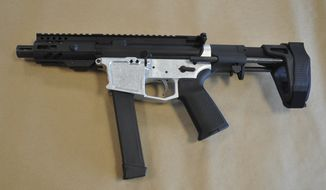 """This undated file photo provided by the U.S. Attorney's Office in Seattle shows a homemade firearm that federal agents say was recovered on Feb. 6, 2020, from a home in Edmonds, Wash. Idaho Gov. Brad Little signed legislation Monday, May 10, 2021, aimed at thwarting a half-dozen executive actions by President Joe Biden to combat gun violence that include a move to crack down on """"ghost guns"""" — homemade firearms put together from purchased gun parts that lack serial numbers to trace them and are often acquired without background checks. (U.S. Attorney's Office via AP) **FILE**"""