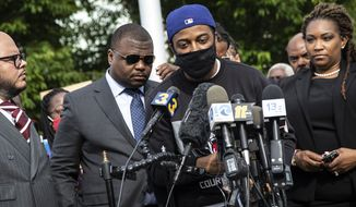 Andrew Brown Jr's son Jha'Rod Ferebee speaks during during a press conference outside the Pasqoutank County Public Safety building in Elizabeth City, N.C., Tuesday, May 11, 2021, after family of Andrew Brown Jr. viewed about 20 minutes of video from the police shooting death of Brown in April. Family attorneys said the longer, redacted video showed Brown did nothing to threaten or provoke deputies and his hands were visible when they approached his car. (Travis Long/The News & Observer via AP)