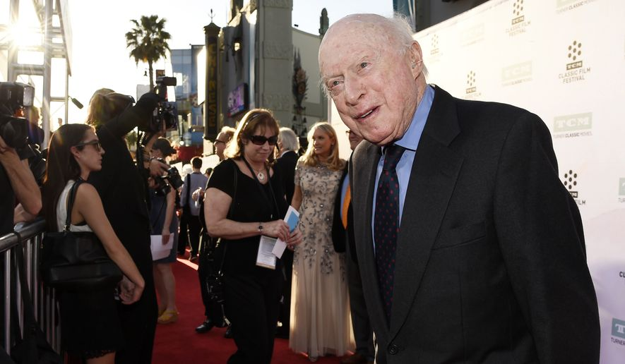 """Norman Lloyd poses before a 50th anniversary screening of the film """"The Sound of Music"""" at the opening night gala of the TCM Classic Film Festival on March 26, 2015, in Los Angeles. Lloyd, the distinguished stage and screen actor known for his role as a kindly doctor on TV's """"St. Elsewhere,"""" has died at 106. (Photo by Chris Pizzello/Invision/AP, File)"""