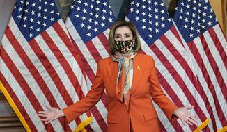 House Speaker Nancy Pelosi of Calif., arrives for a photo opportunity on Capitol Hill in Washington, Tuesday, May 11, 2021. (AP Photo/Susan Walsh)