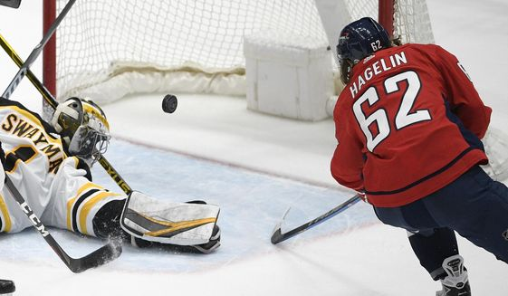 Washington Capitals left wing Carl Hagelin (62) scores a goal past Boston Bruins goaltender Jeremy Swayman (1) during the second period of an NHL hockey game, Tuesday, May 11, 2021, in Washington. (AP Photo/Nick Wass) **FILE**