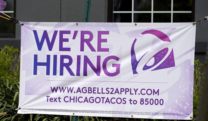 A hiring sign is displayed outside of a restaurant during the COVID-19 pandemic in Glenview, Ill., Saturday, May 8, 2021. US job growth slows sharply in sign of hiring struggles. Employers added just 266,000 jobs in April, sharply lower than in March and far fewer than economists had expected. The unemployment rate rose for the first time since April 2020. (AP Photo/Nam Y. Huh)