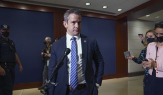 In this file photo, Rep. Adam Kinzinger, R-Ill., speaks to reporters in Washington, Wednesday, May 12, 2021. Mr. Kinzinger is among a minority of House Republicans on the record supporting the $1.2 trillion infrastructure bill on Capitol Hill that is supported by the U.S. Chamber of Commerce.  (AP Photo/J. Scott Applewhite)  **FILE**