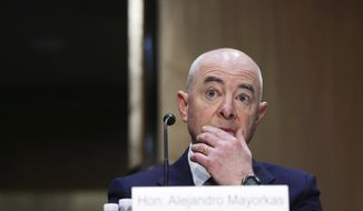 Homeland Security Secretary Alejandro Mayorkas testifies before the Senate Appropriations committee hearing to examine domestic extremism, Wednesday, May 12, 2021 on Capitol Hill in Washington. (Alex Wong/Pool via AP)