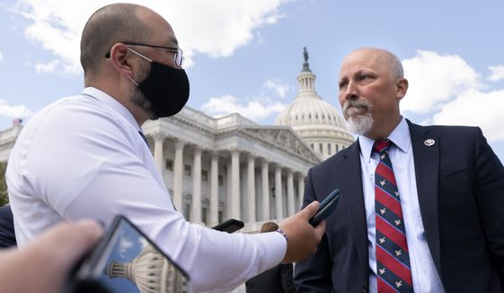 Rep. Chip Roy, R-Texas, right, speaks with reporters after a news conference, Wednesday, May 12, 2021, on Capitol Hill in Washington. (AP Photo/Jacquelyn Martin)