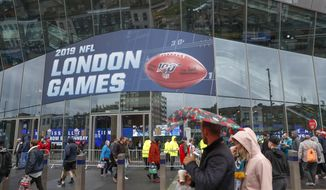NFL football fans arrive at Tottenham Hotspur Stadium to watch an NFL football game between the Tampa Bay Buccaneers and the Carolina Panthers in London, in this Sunday, Oct. 13, 2019, file photo. The NFL is returning to London in October. The first game in London since the coronavirus pandemic will be played on Oct. 10 as the Atlanta Falcons face the New York Jets. A week later, the Jacksonville Jaguars meet the Miami Dolphins. Both games will be played at the stadium of Premier League soccer team Tottenham. The Falcons and the Jaguars will be the home teams. (AP Photo/Alastair Grant, File) **FILE**