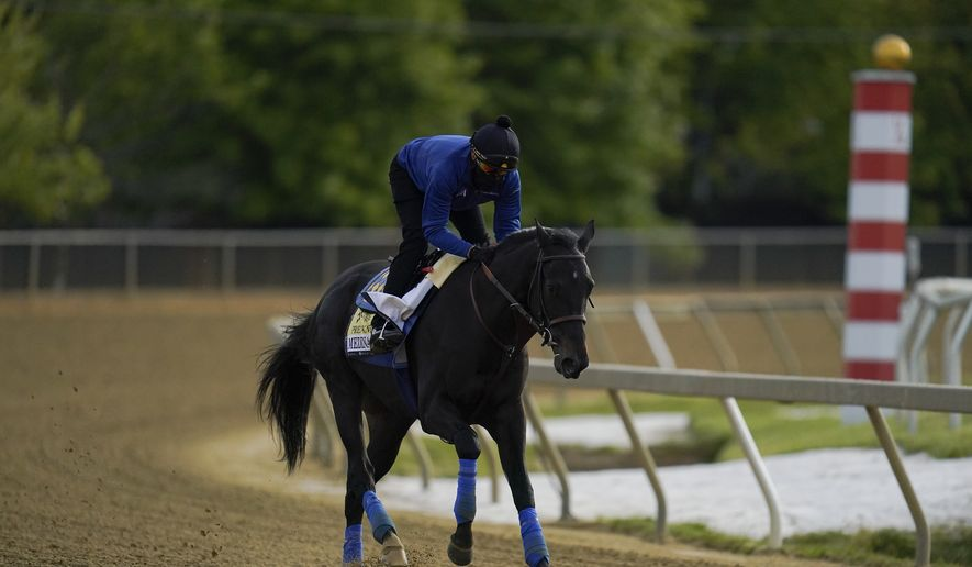 Exercise rider Humberto Gomez takes Kentucky Derby winner and Preakness entrant Medina Spirit over the track during a training session ahead of the Preakness Stakes at Pimlico Race Course, Wednesday, May 12, 2021, in Baltimore. (AP Photo/Julio Cortez) **FILE**