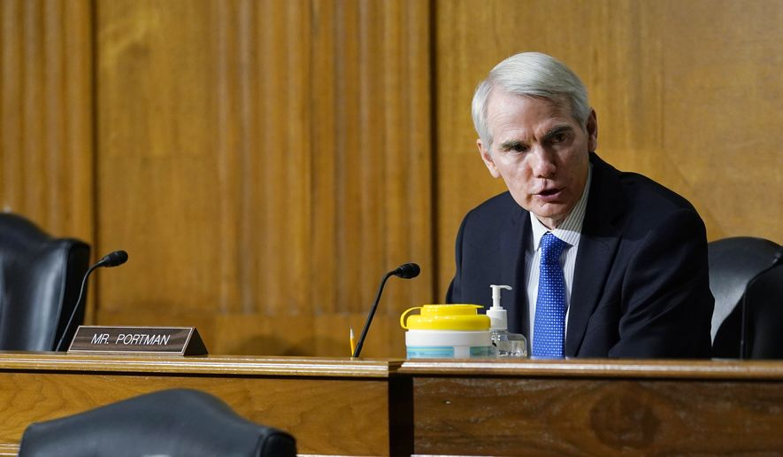 Sen. Rob Portman, R-Ohio, asks a question of United States Trade Representative Katherine Tai as she testifies before the Senate Finance Committee on Capitol Hill in Washington, Wednesday, May 12, 2021, during a hearing to examine President Joe Biden's 2021 trade policy agenda. (AP Photo/Susan Walsh, Pool) ** FILE **