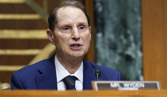 Senate Finance Committee Chairman Sen. Ron Wyden, D-Ore., speaks during a hearing with United States Trade Representative Katherine C. Tai on Capitol Hill in Washington, Wednesday, May 12, 2021. The hearing is to examine President Joe Biden's 2021 trade policy agenda. (AP Photo/Susan Walsh, Pool)