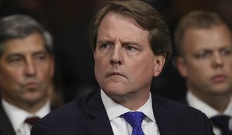 In this Sept. 27, 2018, file photo, then-White House Counsel Don McGahn listens during a hearing on Capitol Hill in Washington. Former White House counsel Don McGahn will answer questions in private from the House Judiciary Committee in an apparent resolution of a long-running dispute over his testimony, according to a court document filed May 12, 2021. (Win McNamee/Pool Image via AP)