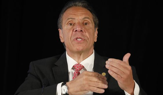 New York Gov. Andrew Cuomo speaks during a press conference at Sahlen Field in Buffalo, N.Y., where the Toronto Blue Jays are scheduled to play several home games due to restrictions in cross-border travel between the U.S. and Canada on Wednesday, May 12, 2021. (Derek Gee/The Buffalo News via AP)