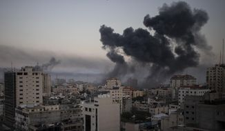 Smoke rises after Israeli airstrikes on Gaza City, Wednesday, May 12, 2021. Rockets streamed out of Gaza and Israel pounded the territory with airstrikes early Wednesday as the most severe outbreak of violence since the 2014 war took on many of the hallmarks of that devastating 50-day conflict, with no endgame in sight. (AP Photo/Khalil Hamra)