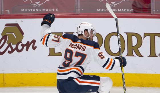 Edmonton Oilers' Connor McDavid (97) celebrates after scoring the winning goal during overtime of an NHL hockey game in Montreal, Monday, May 10, 2021. (Ryan Remiorz/The Canadian Press via AP) **FILE**