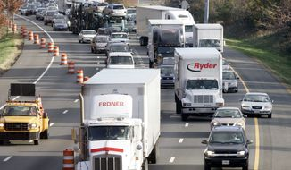 Capital Beltway traffic moves to a crawl in Beltsville, Maryland. State officials have nixed plans to widen most of the Beltway in Maryland after months of opposition. (Associated Press)
