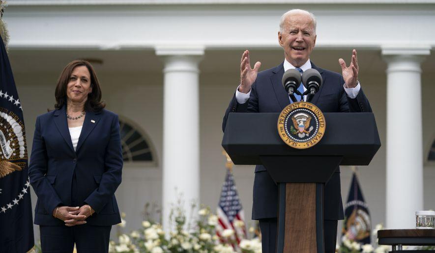 Vice President Kamala Harris listens as President Joe Biden speaks on updated guidance on mask mandates, in the Rose Garden of the White House, Thursday, May 13, 2021, in Washington. (AP Photo/Evan Vucci)