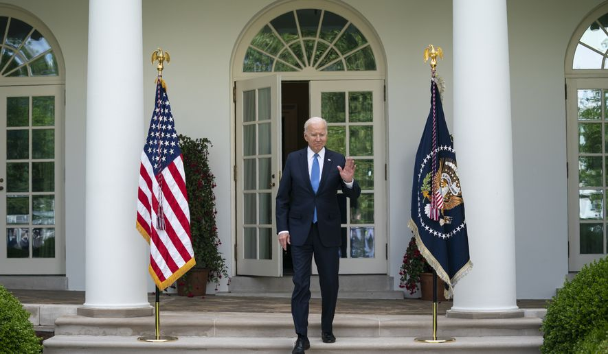 President Joe Biden arrives to deliver remarks on updated guidance on mask mandates, in the Rose Garden of the White House, Thursday, May 13, 2021, in Washington. (AP Photo/Evan Vucci)