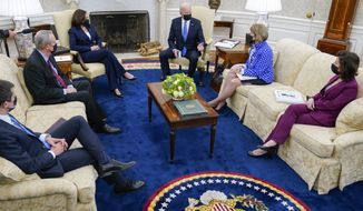 President Joe Biden speaks during a meeting in the Oval Office of the White House, Thursday, May 13, 2021, in Washington. From left, Secretary of Transportation Secretary Pete Buttigieg, Sen. Mike Crapo, R-Idaho, Vice President Kamala Harris, Biden, Sen. Shelley Moore Capito, R-W.Va., and Commerce Secretary Gina Raimondo. (AP Photo/Evan Vucci)