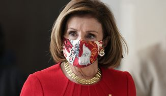 House Speaker Nancy Pelosi, D-Calif., walks to a news conference at the Capitol in Washington, Thursday, May 13, 2021, the day after meeting at the White House with President Joe Biden and Republican leaders on infrastructure. (AP Photo/J. Scott Applewhite)
