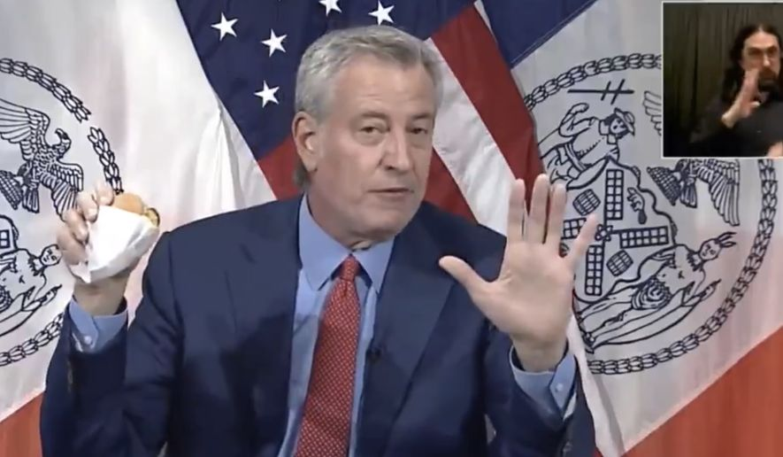 In this file photo from May 13,  2021, New York City Mayor Bill de Blasio uses a press conference to tout a plan to give citizens free burgers if they get a COVID-19 vaccination. While other large cities like Los Angeles have reinstituted or are considering reinstating mask mandates, Mr. de Blasio opposes such a move, instead focusing on getting more New Yorkers fully vaccinated. (Image: NBC-4 New York live stream feed)  **FILE**