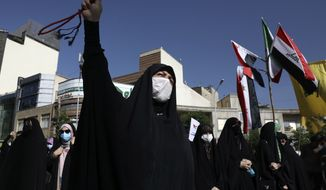 A worshipper chants slogan during a pro-Palestinian demonstration after Eid al Fitr prayers in Tehran, Iran, Thursday, May 13, 2021. Gaza braced for more Israeli airstrikes and communal violence raged across Israel after weeks of protests and violence in Jerusalem. (AP Photo/Vahid Salemi)
