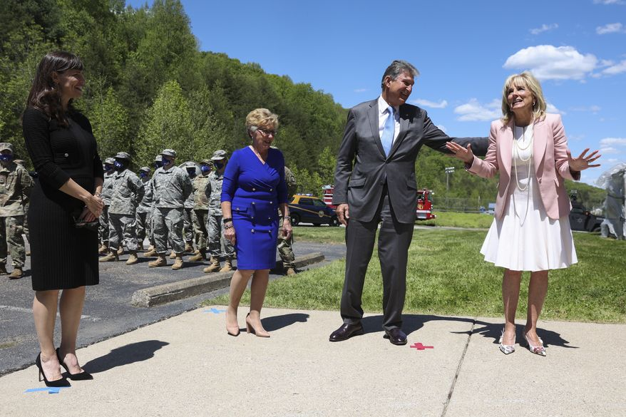 First lady Jill Biden arrives to greet members of the West Virginia National Guard in Charleston, W.Va., Thursday, May 13, 2021, with actress Jennifer Garner and Sen. Joe Manchin, D-W.Va., and his wife Gayle. (Oliver Contreras/The New York Times via AP, Pool)