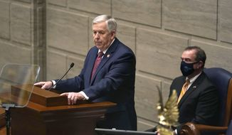 In this Jan. 27, 2021 file photo, Missouri Gov. Mike Parson delivers the State of the State address as Lt. Gov. Mike Kehoe, right, listens in Jefferson City, Mo. (AP Photo/Jeff Roberson, File)