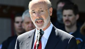 Gov. Tom Wolf speaks at an event Wednesday, May 12, 2021, in Mechanicsburg, Pa. Republican lawmakers in many states have tried to roll back the emergency powers governors exercised during the COVID-19 pandemic, as they shut business, sent students home for distance learning and mandated mask-wearing in public. In Pennsylvania, the GOP-controlled Legislature is taking its case to the votes. Twin constitutional amendments on the primary ballot on Tuesday, May 18 would undercut the authority of Wolf and all future governors to take executive action during an emergency, whether it's another pandemic or natural disaster. (AP Photo/Marc Levy)