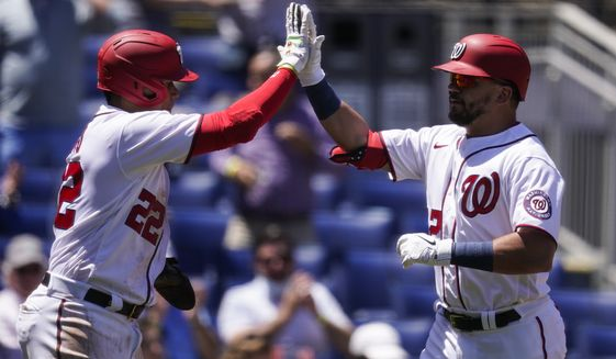 Washington Nationals' Juan Soto, left, celebrates with Kyle Schwarber after Schwarber's two-run homer during the first inning of a baseball game against the Philadelphia Phillies at Nationals Park, Thursday, May 13, 2021, in Washington. (AP Photo/Alex Brandon)