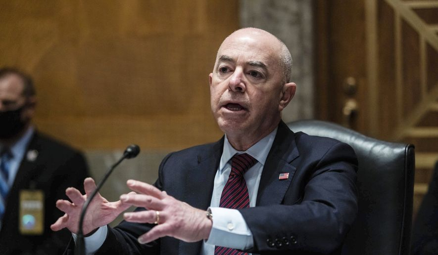 Homeland Security Secretary Alejandro Mayorkas testifies before a Senate Homeland Security and Government Affairs Committee hearing on Capitol Hill, in Washington, Thursday, May 13, 2021. (Graeme Jennings/Pool via AP) ** FILE **