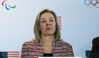 """In this Feb. 18, 2020, file photo, United States Olympic and Paralympic Committee CEO Sarah Hirshland listens during a briefing with the U.S. Olympic and Paralympic Committee and Los Angeles 2028 organizers in Beverly Hills, Calif. A boycott of next year's Beijing Olympics will not solve any geopolitical issues with China and will only serve to place athletes training for the games under a """"cloud of uncertainty,"""" according to a letter, Hirshland, the head of the U.S. Olympic and Paralympic Committee, wrote to Congress on Thursday, May 13, 2021. Her letter specifically addressed those who believe a boycott of the Winter Games next February would serve as an effective diplomatic tool to protest China's alleged abuses toward Uyghurs, Tibetans and Hong Kong residents.  (AP Photo/Evan Vucci, File) **FILE**"""
