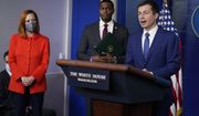 Secretary of Transportation Secretary Pete Buttigieg listens during a press briefing at the White House, Wednesday, May 12, 2021, in Washington. White House press secretary Jen Psaki and Environmental Protection Agency Administrator Michael Regan look on. (AP Photo/Evan Vucci)